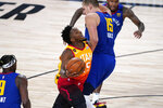 Utah Jazz's Donovan Mitchell, center, is fouled by Denver Nuggets' Nikola Jokic (15) during the second half of an NBA basketball first round playoff game Sunday, Aug. 30, 2020, in Lake Buena Vista, Fla. (AP Photo/Ashley Landis)