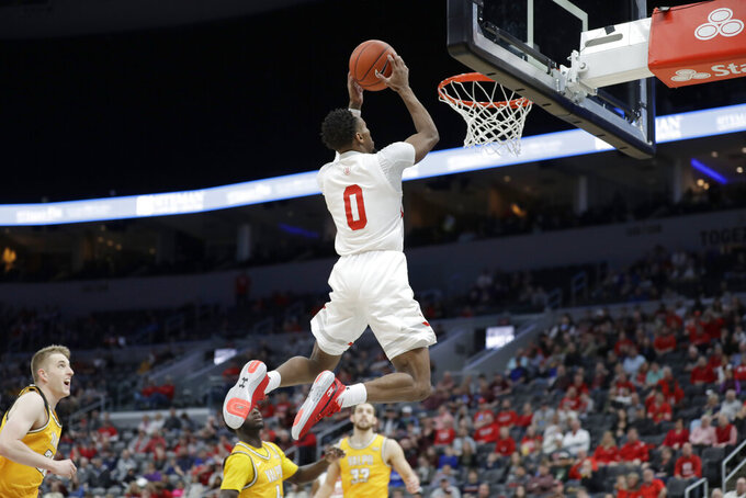 Bradley's Danya Kingsby dunks during the first half of an NCAA college basketball game against Valparaiso in the championship of the Missouri Valley Conference men's tournament Sunday, March 8, 2020, in St. Louis. (AP Photo/Jeff Roberson)