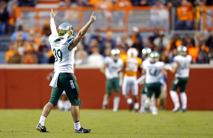 Charlotte punter Kyle Corbett (39) reacts to kicking a 70-yard punt in the second half of an NCAA college football game against Tennessee Saturday, Nov. 3, 2018, in Knoxville, Tenn. Tennessee won 14-3. (AP Photo/Wade Payne)