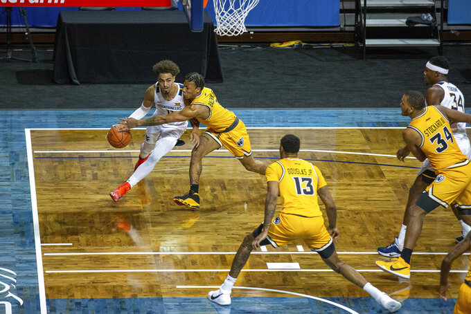West Virginia guard Mile McBride (4) drives to the hoop during the first half of an NCAA college basketball game against VCU, Thursday, Nov. 26, 2020, in SIoux Falls, S.D. (AP Photo/Josh Jurgens)