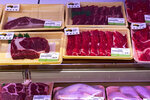 A fridge displaying beef labelled from Australia are on sale at a supermarket in Beijing, Tuesday, Nov. 24, 2020. China has stirred controversy with claims it has detected the coronavirus on packages of imported frozen food. (AP Photo/Andy Wong)