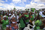 Supporters gather at a party rally to celebrate the presidential candidacy of Henri Konan Bedie for the opposition PDCI-RDA party and as a show of strength ahead of next months presidential election, in Yamoussoukro, Ivory Coast Saturday, Sept. 12, 2020. Bedie, who led the country from 1993-1999, and Pascal Affi N'Guessan of the Ivorian Popular Front party, are the two opposition leaders who pose the strongest threat to incumbent President Alassane Ouattara. (AP Photo/Diomande Ble Blonde)