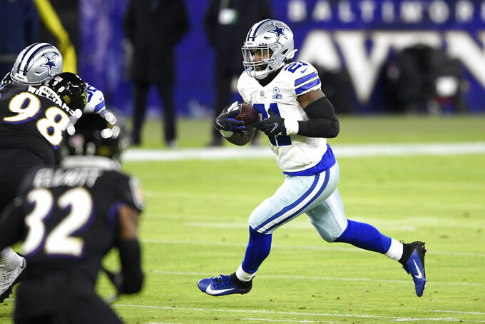 Dallas Cowboys running back Ezekiel Elliott runs with the ball against the Baltimore Ravens during the first half of an NFL football game, Tuesday, Dec. 8, 2020, in Baltimore. (AP Photo/Nick Wass)