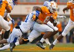 Tennessee running back Ty Chandler (8) runs for yardage as he's tackled by Kentucky linebacker Jordan Jones (34) in the first half of an NCAA college football game Saturday, Nov. 10, 2018, in Knoxville, Tenn. (AP Photo/Wade Payne)