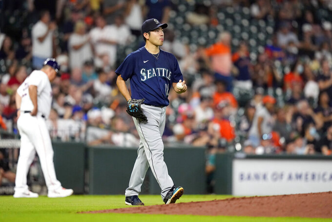 Seattle Mariners starting pitcher Yusei Kikuchi (18) walks back to the mound after giving up a hit during the second inning of a baseball game against the Houston Astros Monday, Sept. 6, 2021, in Houston. (AP Photo/David J. Phillip)