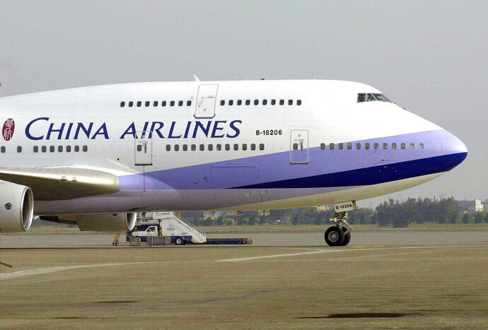 FILE - In this Jan. 26, 2003, file photo, a China Airlines Boeing 747-400 sits on the tarmac at the Chiang Kai-shek International airport in Taoyuan, Taiwan. Pilots from Taiwan's China Airlines have gone on strike during the Lunar New Year travel rush Friday, Feb. 8, 2019, in Taiwan, forcing the cancellation of 18 flights over coming days. (AP Photo/Jerome Favre, File)