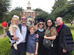 In this May 14, 2019 photo courtesy Megan Lively, center, poses after she graduated from Southeastern Baptist Theological Seminary in Wake Forest, N.C., with a Master of Arts in Christian studies. From left, Charlotte Grey, held by Vincent Lively, son Joseph Reed Lively, Megan Lively, Charlotte Akin, and Daniel Akin, president of the seminary.  It's been a year and a half since Lively, revealed she was the woman who was encouraged by Paige Patterson, then president of the seminary, not to report her rape by a fellow student to the police. That allegation, cited by leaders of a Southern Baptist seminary, helped get Patterson fired as president of Southwestern Baptist Theological Seminary in Fort Worth, Texas, last year. It also helped move the Southern Baptist Convention toward a reckoning with sex abuse.(Courtesy Megan Lively via AP)