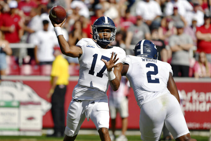 Georgia Southern quarterback Justin Tomlin (17) drops back to pass against Arkansas during the first half of an NCAA college football game Saturday, Sept. 18, 2021, in Fayetteville, Ark. (AP Photo/Michael Woods)