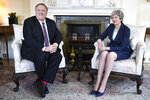US Secretary of State Mike Pompeo meets with Britain's Prime Minister Theresa May, right, at 10 Downing Street in central London, Wednesday May 8, 2019. U.S. Secretary of State Mike Pompeo is in London for talks with British officials on the status of the special relationship between the two nations amid heightened tensions with Iran and uncertainty over Britain's exit from the European Union. (Mandel Ngan/Pool via AP)