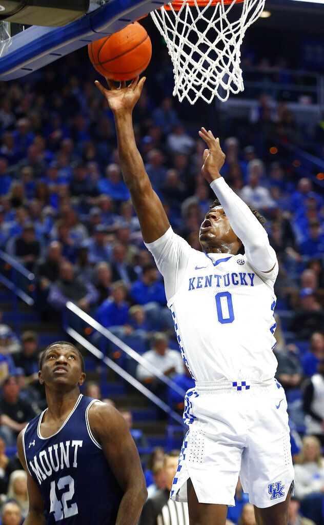Kentucky's Ashton Hagans (0) shoots near Mount St. Mary's Malik Jefferson (42) during the first half of an NCAA college basketball game in Lexington, Ky., Friday, Nov. 22, 2019. (AP Photo/James Crisp)