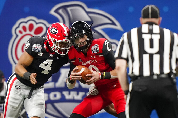 Georgia linebacker Nolan Smith (4) sacks Cincinnati quarterback Desmond Ridder (9) during the second half of the Peach Bowl NCAA college football game, Friday, Jan. 1, 2021, in Atlanta. (AP Photo/Brynn Anderson)