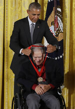FILE - In this Sept. 22, 2016, file photo, President Barack Obama awards the 2015 National Humanities Medal to author Rudolfo Anaya during a ceremony in the East Room of the White House in Washington. Anaya, 82, who helped launch the 1970s Chicano Literature Movement with his novel