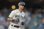 Seattle Mariners' Mitch Haniger runs the bases after he hit a solo home run against the Oakland Athletics during the third inning of a baseball game Saturday, July 24, 2021, in Seattle. (AP Photo/Ted S. Warren)
