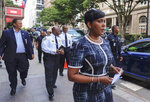 """Atlanta Mayor Keisha Lance Bottoms, right, followed by Atlanta Police Chief Rodney Bryant, said two officers were """"ambushed"""" while responding to a report of a shooting in a building in the city's Midtown area in Atlanta, Wednesday, June 30, 2021. The officers returned fire, killing one suspect, police said. (Ben Gray/Atlanta Journal-Constitution via AP)"""