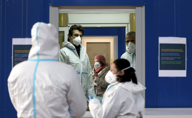A medical workers works in a COVID-19 set up for rapid new coronavirus testing in Vienna, Austria, Monday, Nov. 30, 2020. The Austrian government has moved to restrict freedom of movement for people, in an effort to slow the onset of the COVID-19 disease and the spread of the coronavirus. (AP Photo/Ronald Zak)