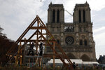 Carpenters put the skills of their Medieval colleagues on show on the plaza in front of Notre Dame Cathedral in Paris, France, Saturday, Sept. 19, 2020, the day honoring European heritage, by reproducing for the public a section of the elaborate carpentry used when the edifice was built. The elaborate wooden beams went up in flames in a devastating April 2019 fire that also toppled the spire of the cathedral, now being renovated. (AP Photo/Francois Mori)