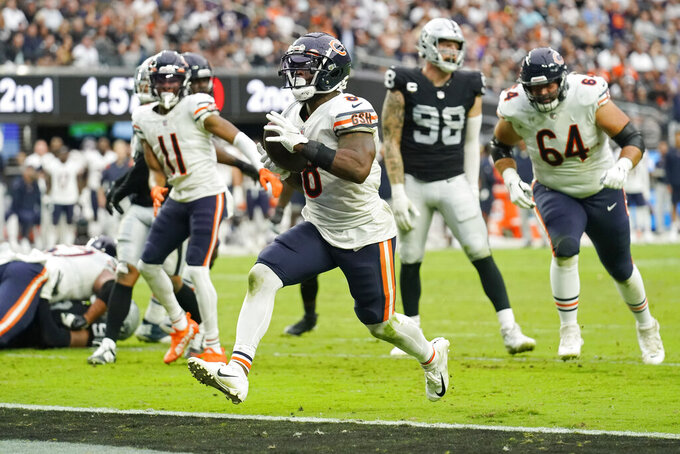 Chicago Bears running back Damien Williams (8) scores a touchdown against the Las Vegas Raiders during the first half of an NFL football game, Sunday, Oct. 10, 2021, in Las Vegas. (AP Photo/Rick Scuteri)