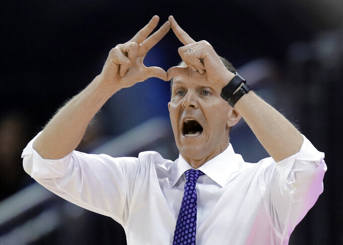 Washington coach Mike Hopkins signals to his team during the first half of an NCAA college basketball game against Oregon State, Wednesday, March 6, 2019, in Seattle. (AP Photo/Ted S. Warren)
