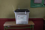 A ballot box is seen on the first day of the parliamentary election inside a polling station in Giza, Egypt, Saturday, Oct. 24, 2020. Egyptians began voting Saturday in the first stage of a parliamentary election, a vote that is highly likely to produce a toothless House of Representatives packed with supporters of President Abdel-Fattah el-Sissi. (AP Photo/Nariman El-Mofty)