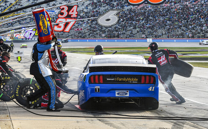 Daniel Suarez's (41) pit crew services his car during a NASCAR Cup Series auto race at Texas Motor Speedway, Sunday, Nov. 3, 2019, in Fort Worth, Texas. (AP Photo/Randy Holt)