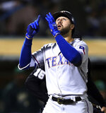 FILE - In this Sept. 7, 2018, file photo, Texas Rangers' Joey Gallo celebrates after hitting a two-run home run against the Oakland Athletics during the fourth inning of a baseball game, in Oakland, Calif. Gallo is back as a full-time outfielder after consecutive 40-homer seasons. (AP Photo/Ben Margot, File)