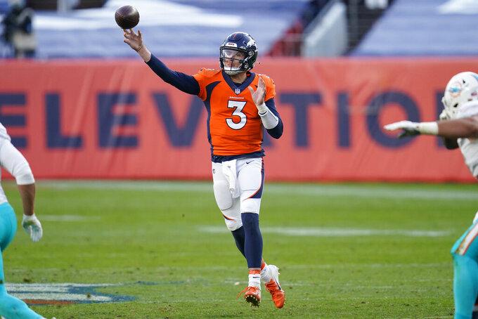 Denver Broncos quarterback Drew Lock (3) throws against the Miami Dolphins during the second half of an NFL football game, Sunday, Nov. 22, 2020, in Denver. (AP Photo/David Zalubowski)