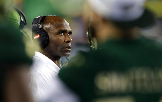 South Florida coach Charlie Strong watches from the bench area during the second half of the team's Gasparilla Bowl NCAA college football game against Marshall on Thursday, Dec. 20, 2018, in Tampa, Fla. (AP Photo/Chris O'Meara)