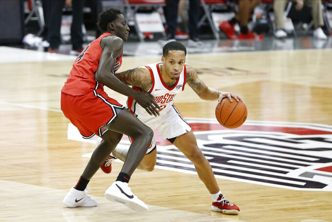 Ohio State's C.J. Walker, right, drives to the basket against Illinois State's Abdou Ndiaye during the second half of an NCAA college basketball game Wednesday, Nov. 25, 2020, in Columbus, Ohio. Ohio State beat Illinois State 94-67. (AP Photo/Jay LaPrete)
