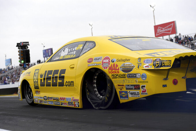 In this photo provided by the NHRA, Jeg Coughlin drives in Pro Stock qualifying Friday, Feb. 21, 2020, at the NHRA Arizona Nationals drag races in Chandler, Ariz. Coughlin took the provisional No. 1 spot with a 6.536-second pass at 208.46 mph. (Marc Gewertz/NHRA via AP)