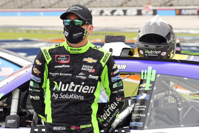 NASCAR Xfinity Series driver Ross Chastain (10) stands next to his car before a NASCAR Xfinity Series auto race at Texas Motor Speedway in Fort Worth, Texas, Saturday Oct. 24, 2020. (AP Photo/Richard W. Rodriguez)