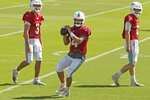 Miami Dolphins quarterbacks Ryan Fitzpatrick (14) Josh Rosen (3) and Jake Rudock (5) run drills during practice in Davie, Fla., Wednesday, Oct. 16, 2019. The winless Miami Dolphins have again changed starting quarterbacks because rookie coach Brian Flores changed his mind. Ryan Fitzpatrick will make his first start since Week 2 when the Dolphins play at Buffalo on Sunday. (David Santiago/Miami Herald via AP)