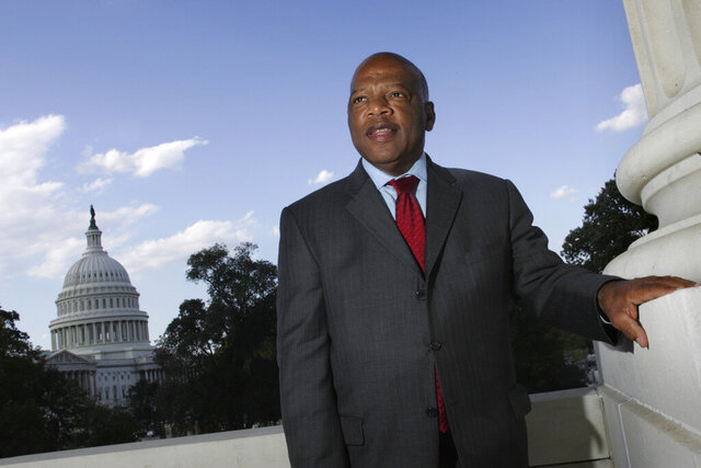 FILE - In this Wednesday, Oct. 10, 2007, file photo, with the Capitol Dome in the background, U.S. Rep. John Lewis, D-Ga., is seen on Capitol Hill in Washington. Lewis, who carried the struggle against racial discrimination from Southern battlegrounds of the 1960s to the halls of Congress, died Friday, July 17, 2020. (AP Photo/Lawrence Jackson, File)