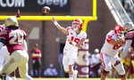 Clemson quarterback Trevor Lawrence throws in the first half of an NCAA college football game against Florida State in Tallahassee, Fla., Saturday, Oct.27, 2018. Clemson defeated Florida State 59-10. (AP Photo/Mark Wallheiser)