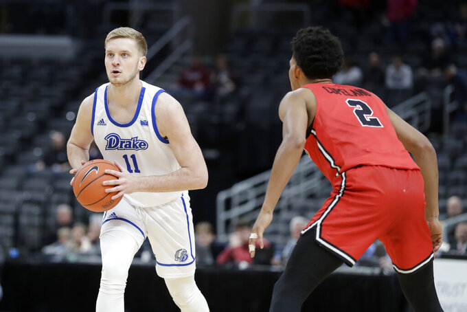 Drake's Antonio Pilipovic (11) looks to pass as Illinois State's Zach Copeland (2) defends during the first half of an NCAA college basketball game in the first round of the Missouri Valley Conference men's tournament Thursday, March 5, 2020, in St. Louis. (AP Photo/Jeff Roberson)