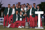 The USA team holds the trophy after winning the Walker Cup golf tournament against the Great Britain and Ireland team at the Seminole Golf Club on Sunday, May 9, 2021, in Juno Beach, Fla. (AP Photo/Brynn Anderson)
