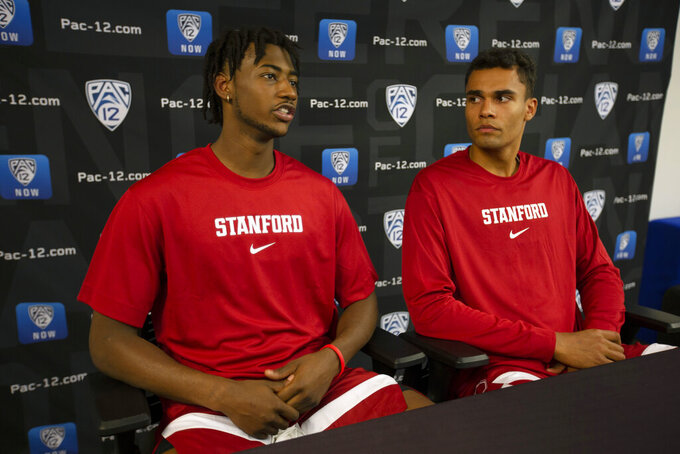 Stanford's Daejon Davis, left, and Oscar da Silva speak during the Pac-12 NCAA college basketball media day in San Francisco, Tuesday, Oct. 8, 2019. (AP Photo/D. Ross Cameron)