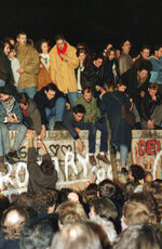 FILE - In this Saturday Nov. 11, 1989 file photo, hundreds of Berliners climb on top of the Berlin Wall at Brandenburg Gate in Berlin, demanding in a peaceful protest that the wall will be pulled down. (AP Photo/Lutz Schmidt, File)