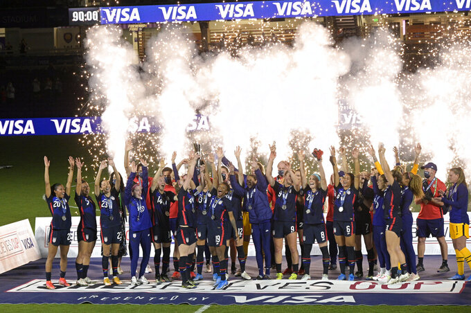 United States players and coaches celebrate during the trophy presentation after a SheBelieves Cup women's soccer match against Argentina, Wednesday, Feb. 24, 2021, in Orlando, Fla. (AP Photo/Phelan M. Ebenhack)