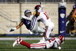 Kansas State running back James Gilbert is tackled by Oklahoma safety Pat Fields (10) during the first half of an NCAA college football game Saturday, Oct. 26, 2019, in Manhattan, Kan. (AP Photo/Charlie Riedel)
