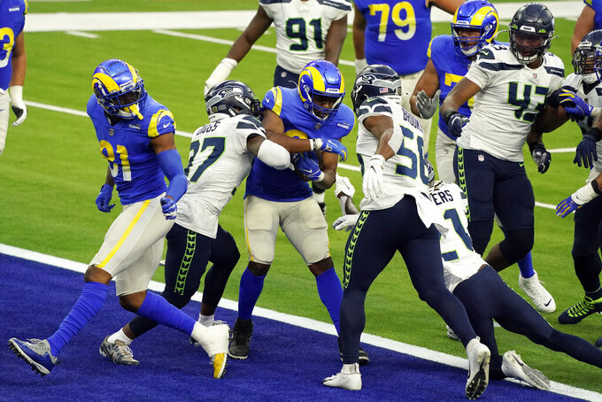 Los Angeles Rams running back Malcolm Brown, center, scores a rushing touchdown against the Seattle Seahawks during the second half of an NFL football game Sunday, Nov. 15, 2020, in Inglewood, Calif. (AP Photo/Ashley Landis )