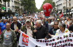 Retired people march during a rally in Paris, France, Thursday, June 14, 2018. Thousands of retired French workers have taken to the streets across the country over a tax hike on their pensions. (AP Photo/Michel Euler)