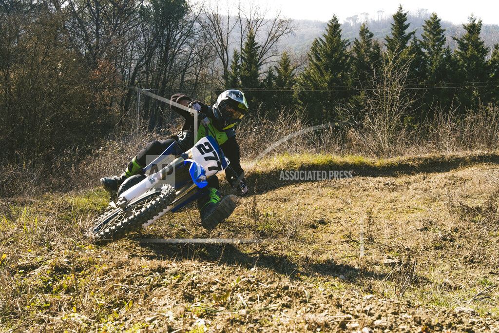 Motocross driver riding on circuit