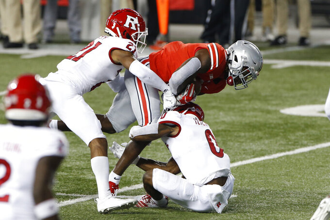 Rutgers defensive backs Tre Avery, left, and Christian Izien, right, tackle Ohio State running back Trey Sermon during the first half of an NCAA college football game Saturday, Nov. 7, 2020, in Columbus, Ohio. (AP Photo/Jay LaPrete)