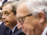 Former U.K. Independence Party (UKIP) leader Nigel Farage arrives for a plenary session next to EU Commission President Jean Claude Juncker at the European Parliament in Brussels on Wednesday Jan. 30, 2019. Leaders across the European Union offered a united chorus of