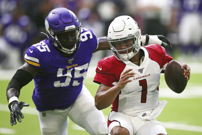 Arizona Cardinals quarterback Kyler Murray (1) runs from Minnesota Vikings defensive end Ifeadi Odenigbo (95) during the first half of an NFL preseason football game, Saturday, Aug. 24, 2019, in Minneapolis. (AP Photo/Jim Mone)