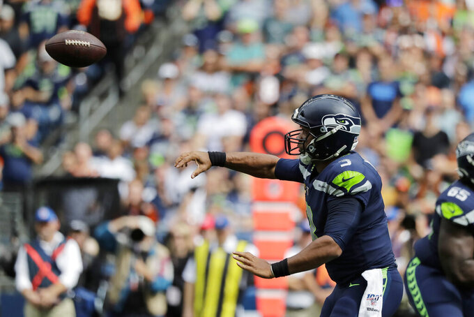 Seattle Seahawks quarterback Russell Wilson passes against the Cincinnati Bengals during the first half of an NFL football game, Sunday, Sept. 8, 2019, in Seattle. (AP Photo/John Froschauer)