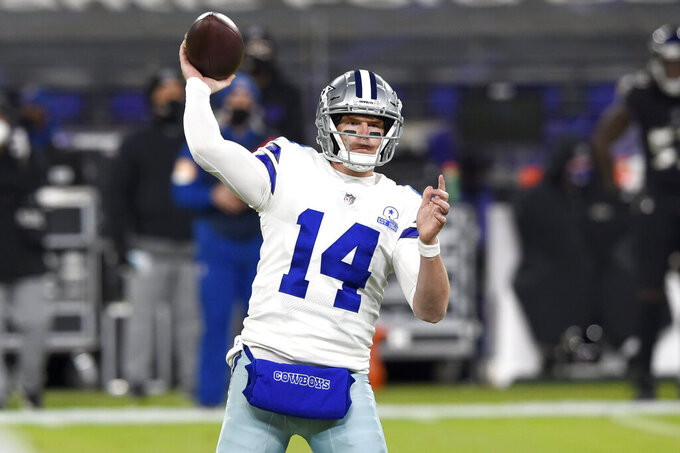 Dallas Cowboys quarterback Andy Dalton throws a pass against the Baltimore Ravens during the first half of an NFL football game, Tuesday, Dec. 8, 2020, in Baltimore. (AP Photo/Gail Burton)