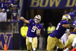 Washington quarterback Dylan Morris throws against California in the first half of an NCAA college football game Saturday, Sept. 25, 2021, in Seattle. (AP Photo/Elaine Thompson)