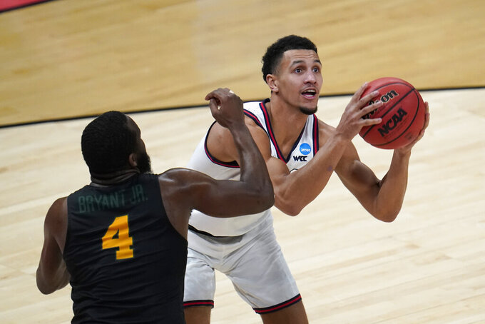 Gonzaga guard Jalen Suggs (1) drives on Norfolk State guard Joe Bryant Jr. (4) during the second half of a men's college basketball game in the first round of the NCAA tournament at Bankers Life Fieldhouse in Indianapolis, Saturday, March 20, 2021. (AP Photo/Paul Sancya)