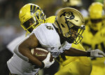 Colorado's Alex Fontenot rushes against Oregon during the first quarter of an NCAA college football game Friday, Oct. 11, 2019, in Eugene, Ore. (AP Photo/Chris Pietsch)